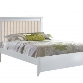 White double bed with green sheet and talc headboard panel