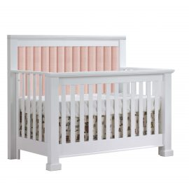 White crib with channel tufted headboard panel in blush
