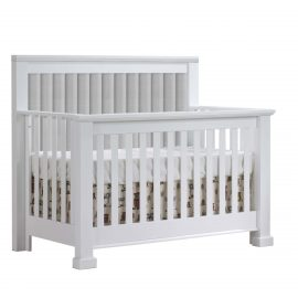 White crib with channel tufted headboard panel in linen grey