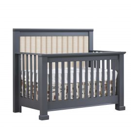 Dark grey charcoal crib with channel tufted headboard panel in talc