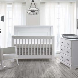 White nursery with white crib and double dresser