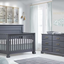 Nursery with crib and double dresser in charcoal grey
